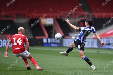 Ashton Gate Stadium, Bristol, England; Kieran Lee of Sheffield Wednesday tries to control the high ball under pressure from Andreas Weimann of Bristol City; English Football League Championship Football, Bristol City versus Sheffield Wednesday.