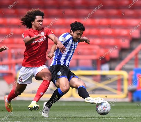 Ashton Gate Stadium, Bristol, England; Kadeem Harris of Sheffield Wednesday holds off the chllenge from Han; English Football League Championship Football, Bristol City versus Sheffield Wednesday.