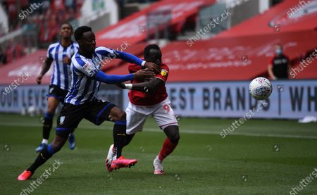 Ashton Gate Stadium, Bristol, England; Kadeem Harris of Sheffield Wednesday competes for the ball with Famara Diedhiou of Bristol City; English Football League Championship Football, Bristol City versus Sheffield Wednesday.