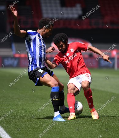 Ashton Gate Stadium, Bristol, England; Jacob Murphy of Sheffield Wednesday competes for the ball with Jay Dasilva of Bristol City along the wing; English Football League Championship Football, Bristol City versus Sheffield Wednesday.