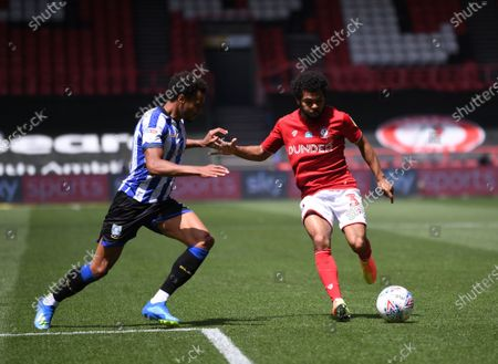 Ashton Gate Stadium, Bristol, England; Jacob Murphy of Sheffield Wednesday competes for the ball with Jay Dasilva of Bristol City; English Football League Championship Football, Bristol City versus Sheffield Wednesday.