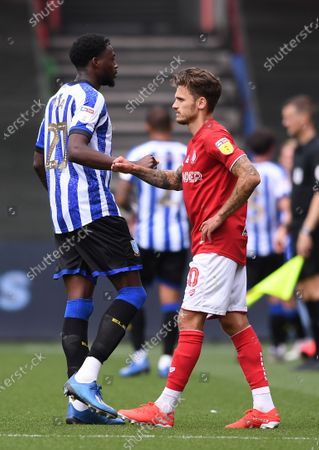 Ashton Gate Stadium, Bristol, England; a dejected Jamie Paterson of Bristol City bumpd arms with Dominic Iorfa of Sheffield Wednesday after the match; English Football League Championship Football, Bristol City versus Sheffield Wednesday.