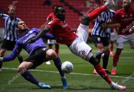 Ashton Gate Stadium, Bristol, England; Famara Diedhiou of Bristol City is unable to control the ball in the goal mouth under pressure from Joe Wildsmith of Sheffield Wednesday; English Football League Championship Football, Bristol City versus Sheffield Wednesday.