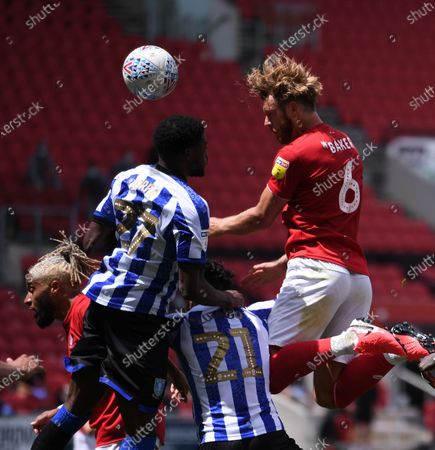 Ashton Gate Stadium, Bristol, England; Nathan Baker of Bristol City heads at goal under pressure Dominic Iorfa of Sheffield Wednesday; English Football League Championship Football, Bristol City versus Sheffield Wednesday.