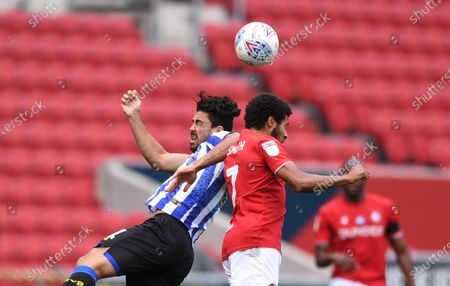 Ashton Gate Stadium, Bristol, England; Korey Smith of Bristol City and Massimo Luongo of Sheffield Wednesday compete in the air; English Football League Championship Football, Bristol City versus Sheffield Wednesday.