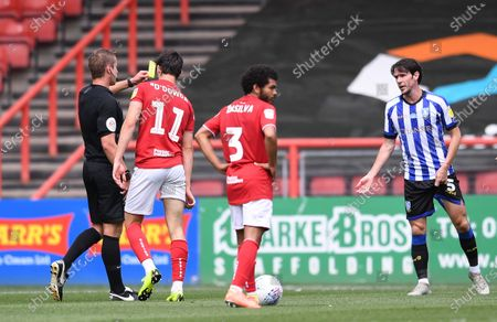 Ashton Gate Stadium, Bristol, England; Referee John Brooks shows a yellow card to Kieran Lee of Sheffield Wednesday for a tackle on Callum O'Dowda of Bristol City; English Football League Championship Football, Bristol City versus Sheffield Wednesday.