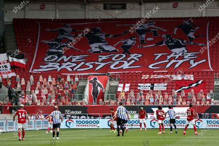 Action during the first half with a large banner in the stands.