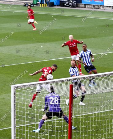 Nahki Wells of Bristol City heads towards goal.