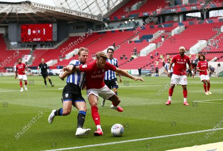 Jordan Rhodes of Sheffield Wednesday and Nathan Baker of Bristol City.