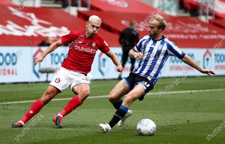 Andreas Weimann of Bristol City and Barry Bannan of Sheffield Wednesday.
