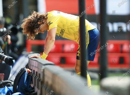 David Luiz of Arsenal feels the pain from a knock