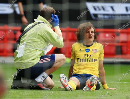 David Luiz of Arsenal feels the pain from an injury