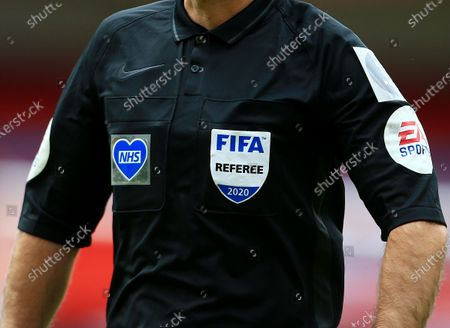 The NHS patch on the shirt worn by referee Mr Paul Tierney