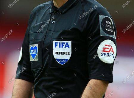 The NHS and Black Lives Matter patches on the shirt worn by referee Mr Paul Tierney