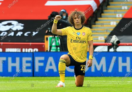 David Luiz of Arsenal takes a knee ahead of the game