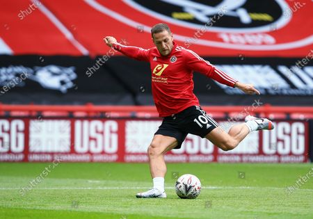 Billy Sharp of Sheffield United warms up ahead of the game