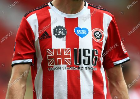 The NHS and Black Lives Matter patches on the shirt worn by Chris Basham of Sheffield United