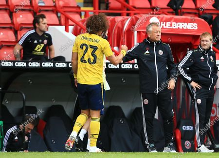 David Luiz of Arsenal with Sheffield United manager Chris Wilder as he leaves the game through injury