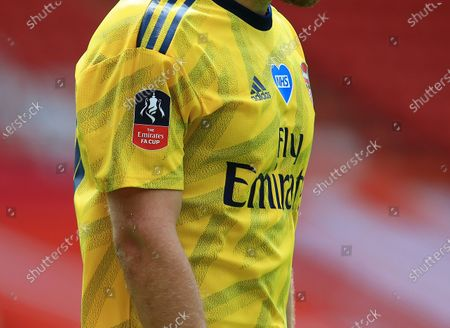 The FA Cup arm patch on the sleeve of the Arsenal shirt