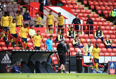 Alexandre Lacazette of Arsenal leads the team out of the stand ahead of the game