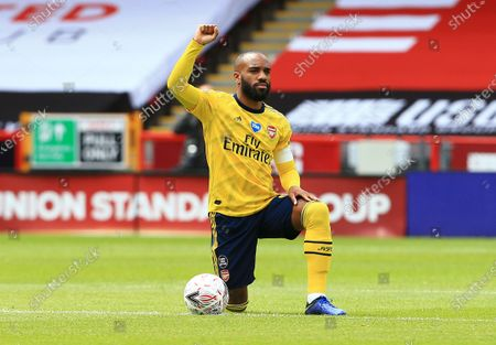 Alexandre Lacazette of Arsenal takes a knee ahead of the game
