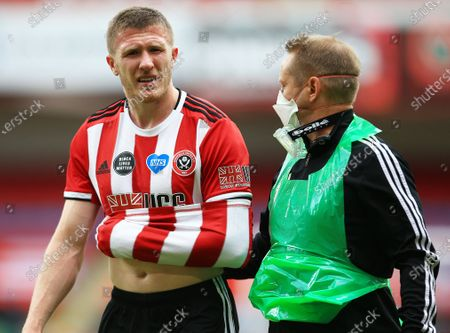 John Lundstram of Sheffield United leaves the game through injury
