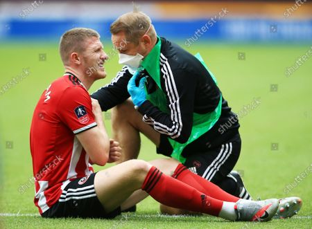 John Lundstram of Sheffield United feels the pain from an injury