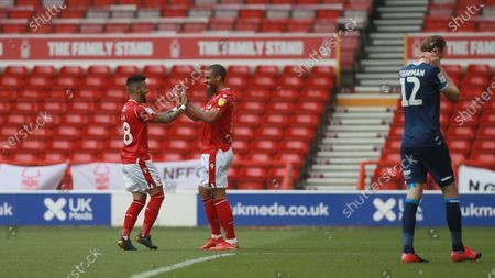 Lewis Grabban celebrates with Tiago Silva During the EFL SkyBet Championship match between Nottingham Forest and Huddersfield Town.
