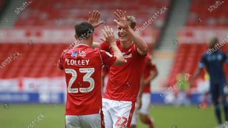 Ryan Yates celebrates with corner taker Joe Lolley During the EFL SkyBet Championship match between Nottingham Forest and Huddersfield Town.