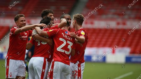 Ryan Yates celebrates with team mates During the EFL SkyBet Championship match between Nottingham Forest and Huddersfield Town.