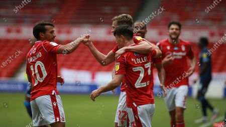 Ryan Yates celebrates with Joao Carvalho and Joe Lolley During the EFL SkyBet Championship match between Nottingham Forest and Huddersfield Town.