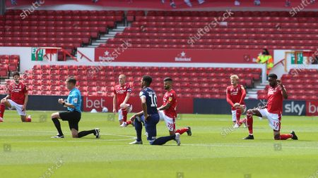Players take a knee at kickoff during the EFL SkyBet Championship match between Nottingham Forest and Huddersfield Town.