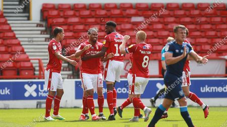 Forest players celebrate with goalscorer Lewis Grabban during the EFL SkyBet Championship match between Nottingham Forest and Huddersfield Town.