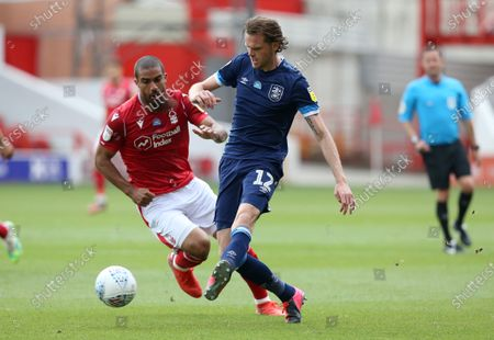 Huddersfield Town's Richard Stearman battles with Nottingham Forest's Lewis Grabban