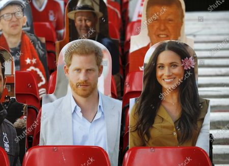 Prince Harry and Meghan are amongst the cardboard fans