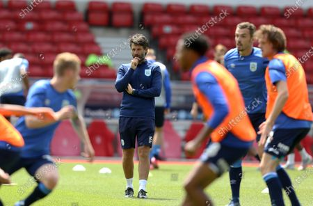 Huddersfield Town's manager Danny Cowley watches the warm up