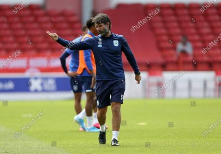 Huddersfield Town's manager Danny Cowley watches warm up