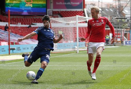 Huddersfield Town's Christopher Schindler clears under pressure from Nottingham Forest's Joe Worrall