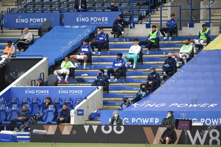 Chelsea substitutes look on.