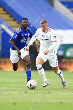 Ross Barkley of Chelsea is challenged by Wilfred Ndidi of Leicester City.