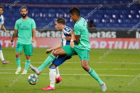 RCDE Stadium, Barcelona, Catalonia, Spain; Embarba is challenged by Varane; La Liga Football, Real Club Deportiu Espanyol de Barcelona versus Real Madrid.