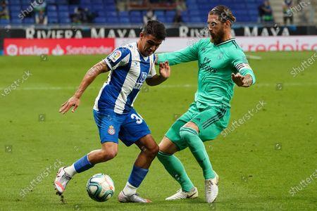 RCDE Stadium, Barcelona, Catalonia, Spain; Camouzano is challenged by Sergio Ramos; La Liga Football, Real Club Deportiu Espanyol de Barcelona versus Real Madrid.