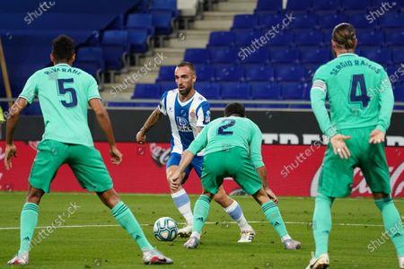 RCDE Stadium, Barcelona, Catalonia, Spain; Marc Roca looks up to see the cover from Madrid as Carvajal challenges; La Liga Football, Real Club Deportiu Espanyol de Barcelona versus Real Madrid.