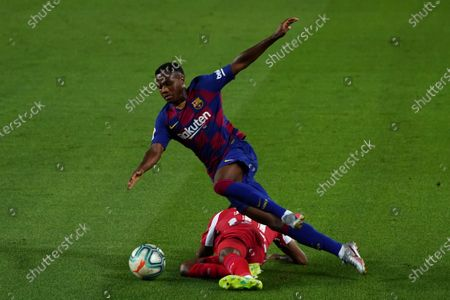 Camp Nou, Barcelona, Catalonia, Spain; Ansu Fati goes over from the challenge from Lemar; La Liga Football, Barcelona versus Atletico Madrid.