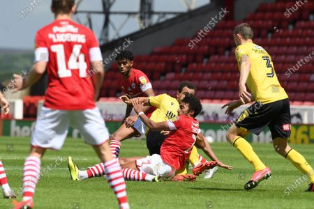 Barnsley's Jacob Brown receives the studs to the chest after this challenge from Mason Bennett