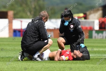 Barnsley's Jacob Brown receives treatment.