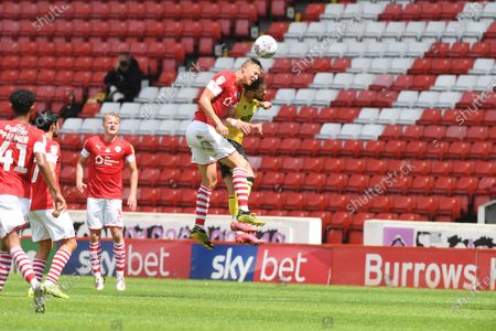 Barnsley's Mads Anderson heads on.