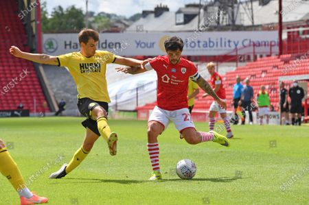 Stock Photo of Barnsley's Alex Mowatt crosses in a ball.