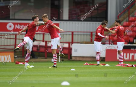 Barnsley's Michael Sollbauer (left) warms up with Mads Andersen.