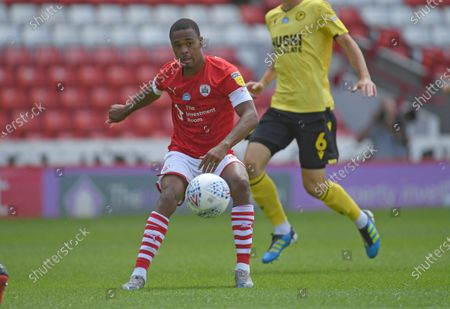 Barnsley's  Elliot Simoes crosses in